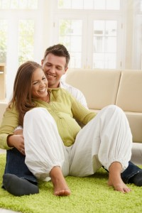 Laughing couple expecting baby